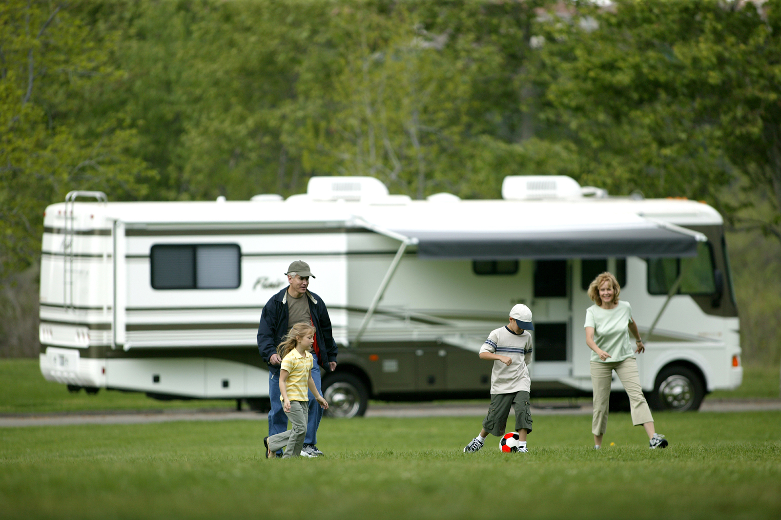 Family Playing By Trailer Rental